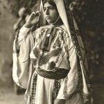 A Palestine peasant girl showing beautifully embroidered costume